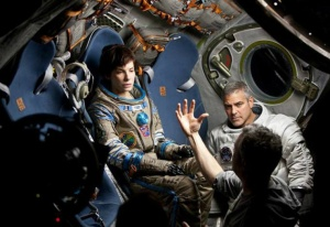 Sandra Bullock and George Clooney take direction