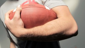 carrying a football