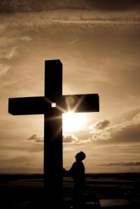 Praying before the cross